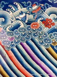 Chinese silk embroidery wave and surf design on a festive dragon robe from the Qing Dynasty
