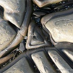 Interesting triangular design in rock pavement at Kimmeridge Bay in Dorset, England