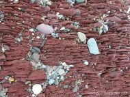 Interesting red texture of Devonian rock on the beach at Fermoyle on the Dingle Peninsula in Ireland