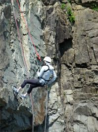 Abseiler on Cape Enrage cliffs