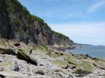 Cliffs and beach boulders at Cape Enrage