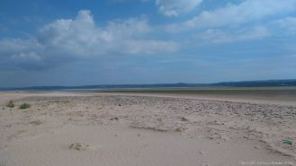 View across the sand-covered pebble bar at Whiteford Point