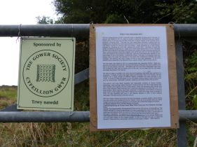 Notice on the gate to Nitten Field