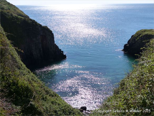 Looking down at the sparkling water in the cove at Church Doors in South Pembrokeshire