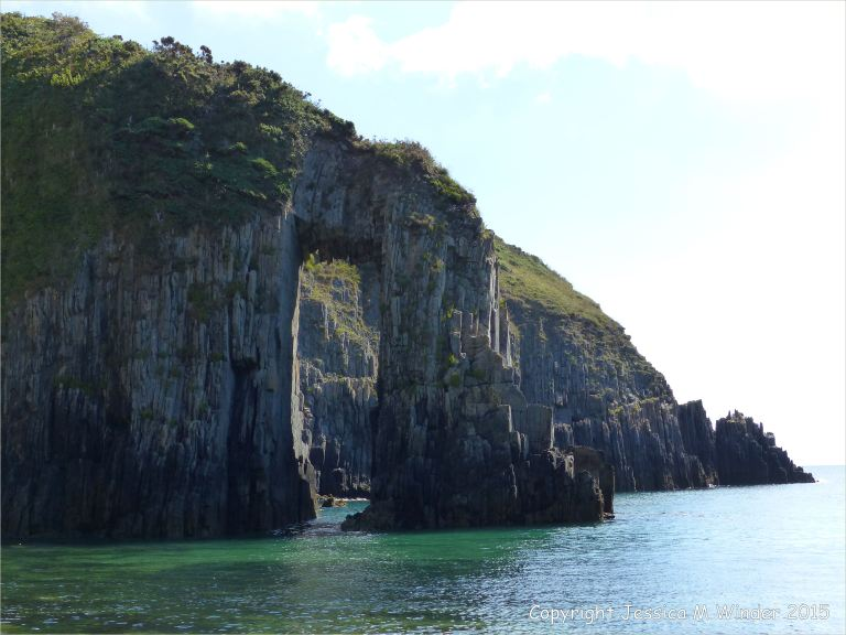Natural arch in the Horseback Carboniferous Black Rock Limestone promontory on the seashore at Church Doors on the South Pembrokeshire Coast in Wales