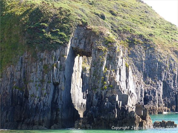 Natural arch in Carboniferous Black Rock Limestone in the Horseback ridge on the seashore at Church Doors on the South Pembrokeshire Coast in Wales
