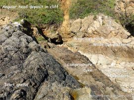 Lamprophyre dyke cutting through Icart Gneiss at Moulin Huet Bay