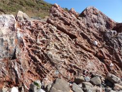 Rock texture and pattern in red haematite in Carboniferous limestone at Worm's Head