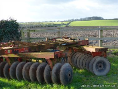 English countryside view with farm machinery