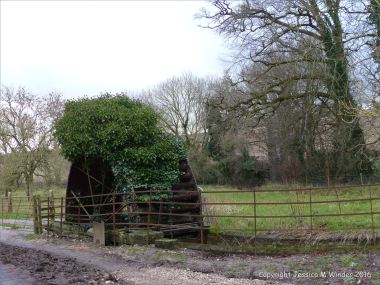 English countryside view with disused iron water wheel