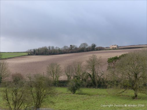 English countryside view with bare ploughed field