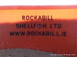 The writing on a flotsam plastic fish crate