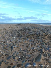 Pebble spit with sand at Whiteford
