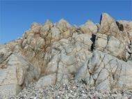 Rock outcrop of L'Eree Granite on the Channel Island of Guernsey with possible 'ghost' xenolith.