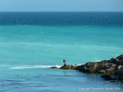 Kayakers enjoy the banded blue waters off the Dorset Coast