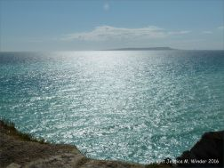 Sunshine sparkles on the blue sea off the Dorset Coast