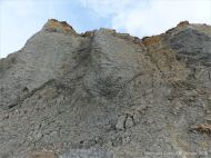 Fine folded rock layers in the cliffs at Seatown in Dorset, England