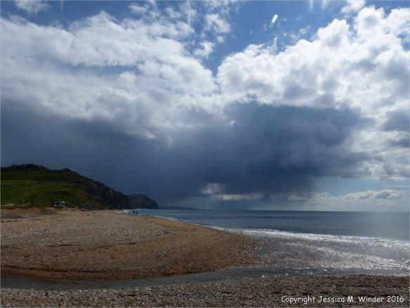 View looking east at Charmouth Beach, Dorset, England.