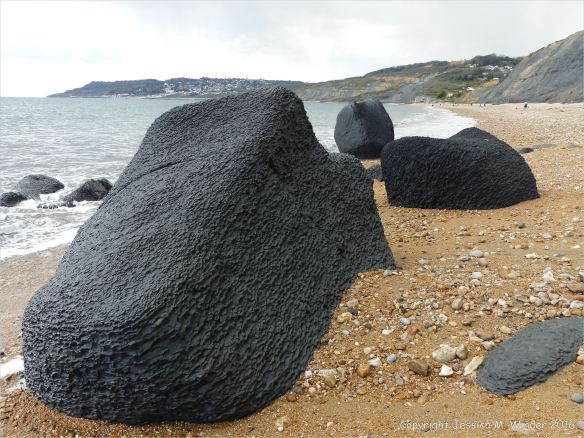 Beach boulders at Charmouth on the World Heritage Jurassic Coast in Dorset, England.