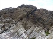 Water-worn limestone rock layers on the Worms Head Causeway in Gower, South Wales.