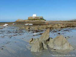 Rocky shore near Fort Grey at Rocquaine Bay