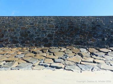 Stone sea wall at Rocquaine Bay