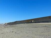 Concrete sea wall in the central part of Rocquaine Bay