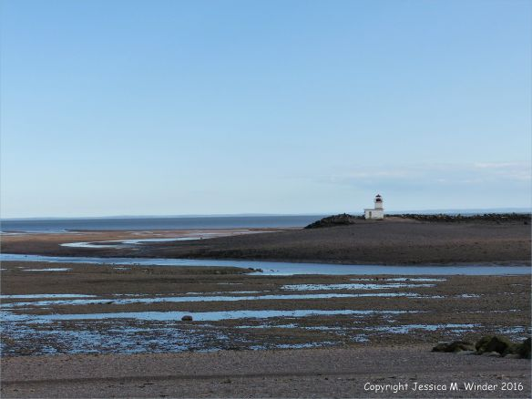 Beachscape with lighthouse at Parrsboro, Nova Scotia, Canada.