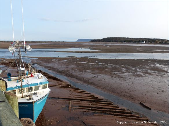 Beachscape with moored boat at Parrsboro, Nova Scotia, Canada.