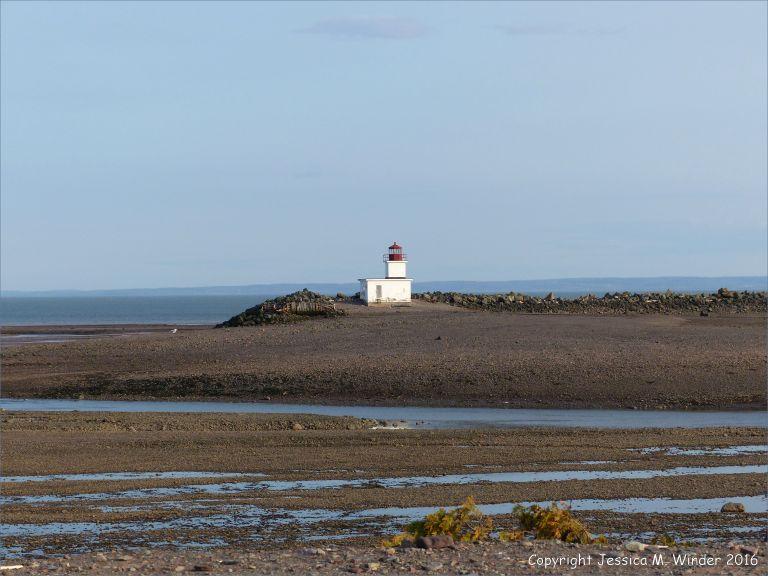 Beachscape with lighthouse at Parrsboro, Nova Scotia, Canada.