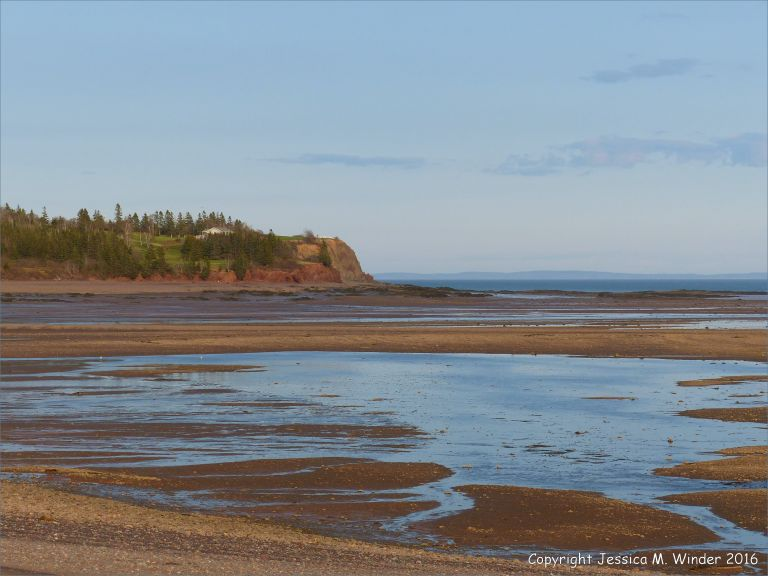 Beachscape with low tide standing water pools at Parrsboro, Nova Scotia, Canada.