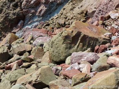 Boulders of basalt, sandstones, and mudstones at the foot of Wasson Bluff