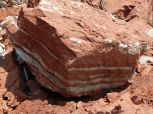 Red and white striped Jurassic McCoy Brook Formation rocks east of Wasson Bluff