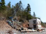 Beach hut near Wasson Bluff with red Jurassic McCoy Brook Formation rocks