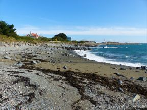 View of the shore at Spur Bay, Guernsey, Channel Islands, looking north.
