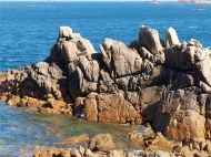 Rocky granite outcrops at Cobo Bay
