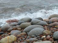 Pebbles at the water's edge at Pleasant Bay in Cape Breton Island