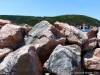Texture and pattern in Devonian plutonic rocks used as rip-rap at White Point Harbour in Cape Breton Island, Nova Scotia, Canada.