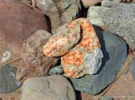 Beach stones with gypsum crystals at Crystal Cliffs Beach