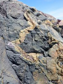 Basalt rock pattern and texture in a Neoproterozoic lava flow at Main a Dieu, Cape breton Island, Nova Scotia, Canada.