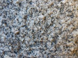 Macro photograph of natural rock pattern and texture in Herm Granodiorite