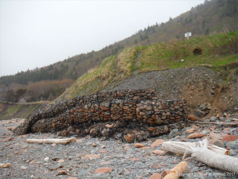 Sea defence gabions filled with beach stones at Corney Brook, Cape Breton Island