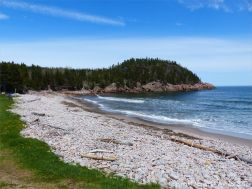 View looking north over the curving pebble banks to the cliffs at Black Brook Cove