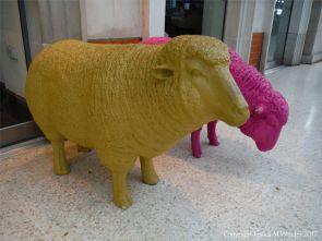 Two colourful sheep on Waterloo Station