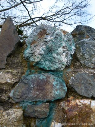 Stone wall with blue copper-stained quartz rock
