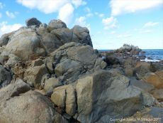 Rocky outcrop on the beach at Rousse Point
