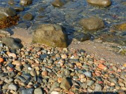 Wet rocks and pebbles at Rousse Point