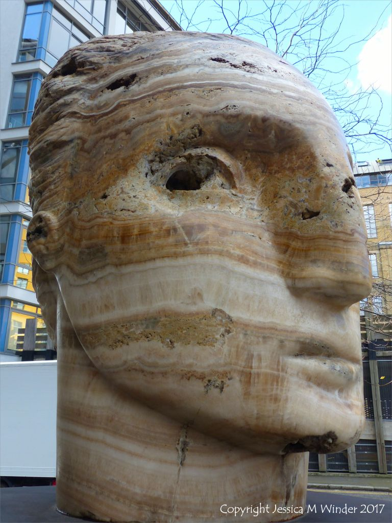 Carved head called Tempesta made from clastic igneous rock by Emily Young