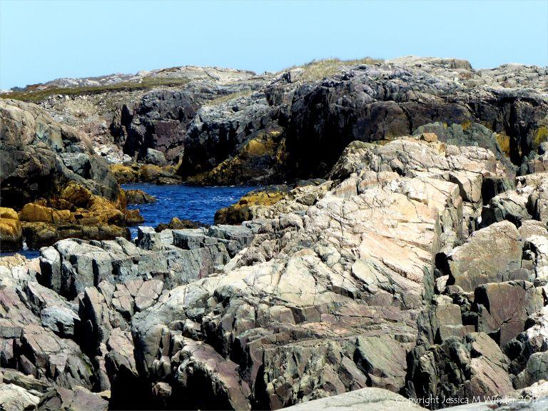 The shoreline with rocks of pyroclastic breccia north of Louisbourg Lighthouse in Cape Breton in Nova Scotia