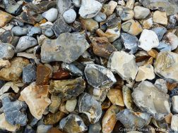 Beach stones derived from the chalk cliffs at South Beach, Studland, Dorset, England.
